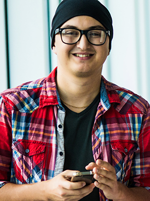 Guy in glasses and plaid shirt smiling